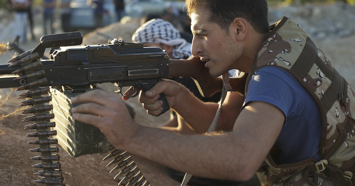 Syrian rebel fighters shoot during target practice in Daraya on August 4, 2012.</p>