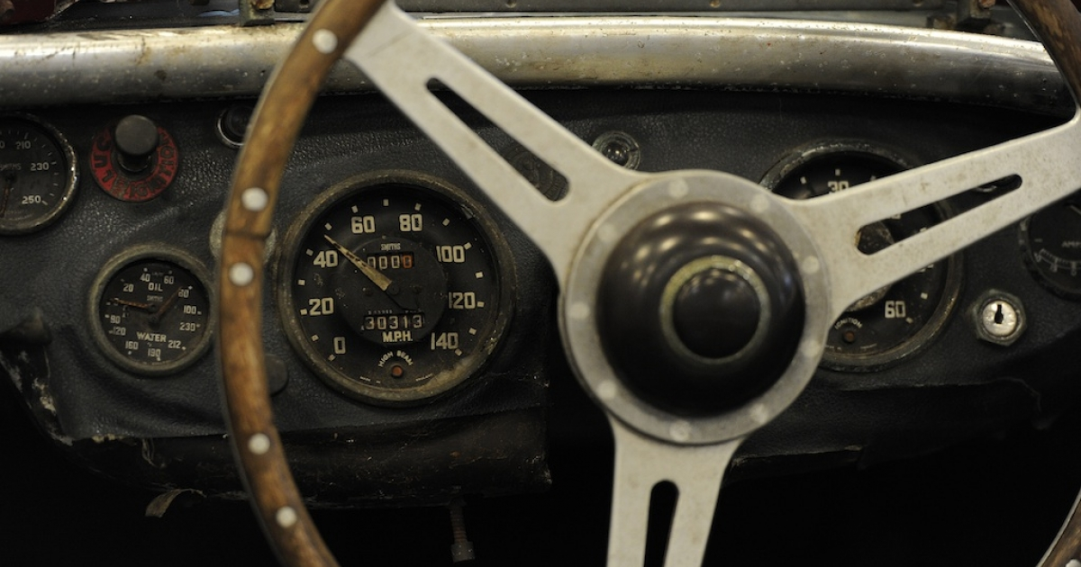 A steering wheel of an Austin Healey.</p>