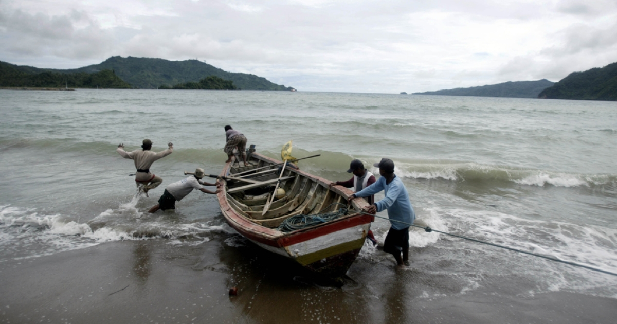 Indonesian fishermen set out to sea from the village of Prigi, while rescuers continue their search for survivors off the coast in East Java province after an overloaded boat carrying about 250 asylum seekers en route to Australia capsized on Dec. 17, 2011.</p>