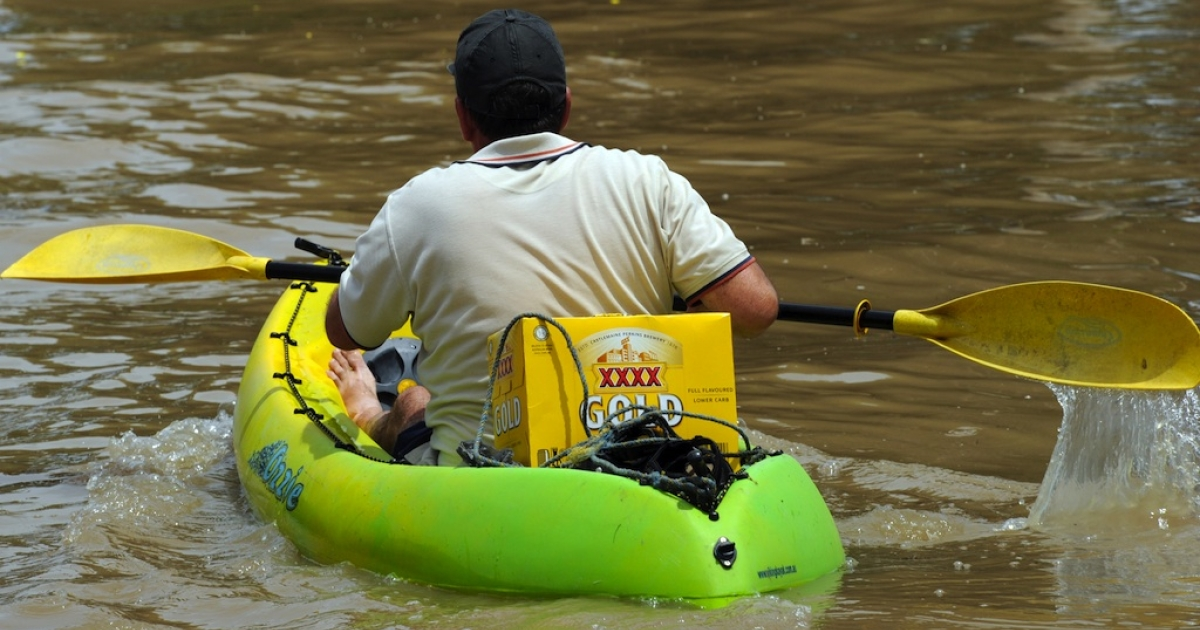 A resident of Rockhampton, Queensland, paddles a kayak loaded with XXXX beer back to his home during the epic Australian floods of January, 2011, when floodwaters covered an area bigger than France and Germany combined and closed major transport links.</p>
