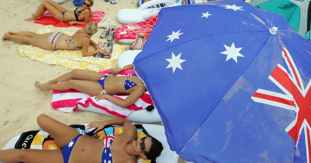 Beachgoers catch some rays at Bondi Beach in Sydney.</p>