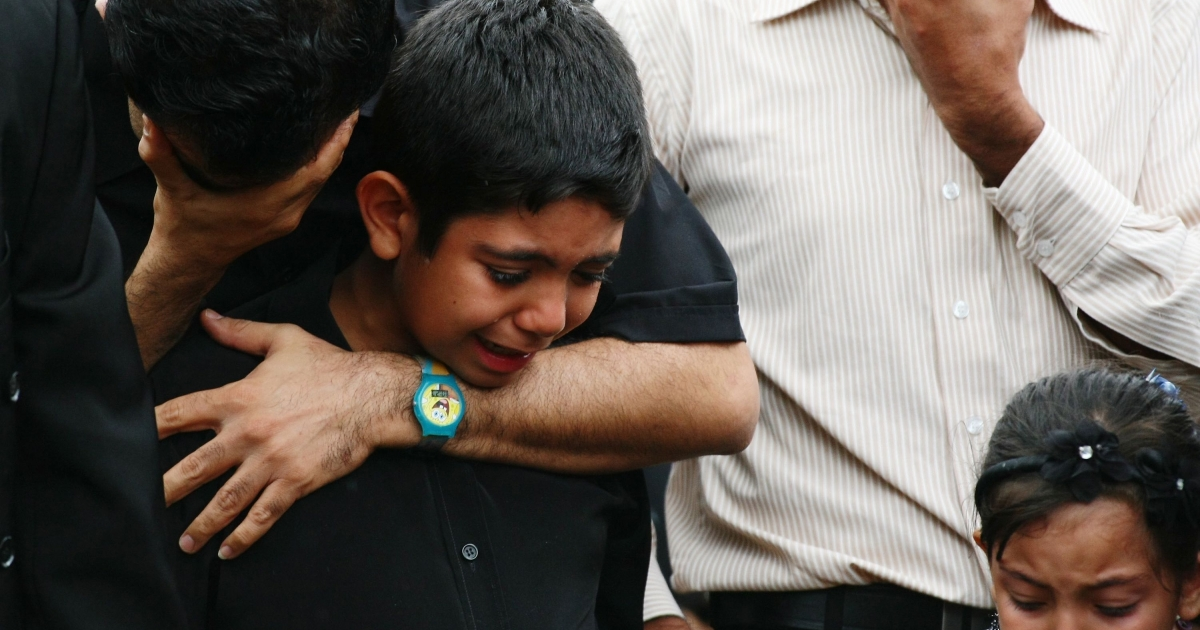 Relatives of some of the 30 killed when a boat full of asylum seekers crashed on the rocks at Christmas Island on Dec. 15, 2010, trying to reach Australian soil, grieve during Muslim and Christian services held Feb. 15, 2011 in Sydney, Australia.</p>