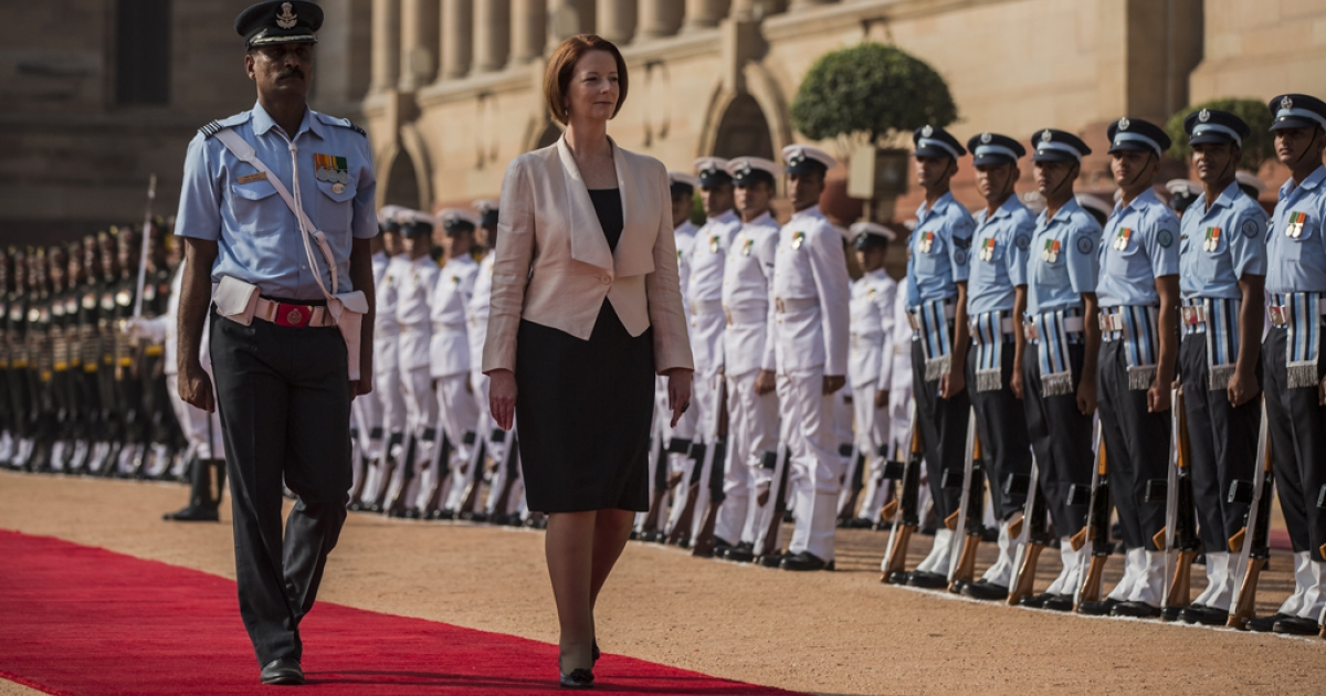 Australian Prime Minister Julia Gillard inspects the guard of honor during her ceremonial reception at the Indian presidential palace Rashtrapati Bhavan on October 17, 2012 in Delhi, India.</p>
