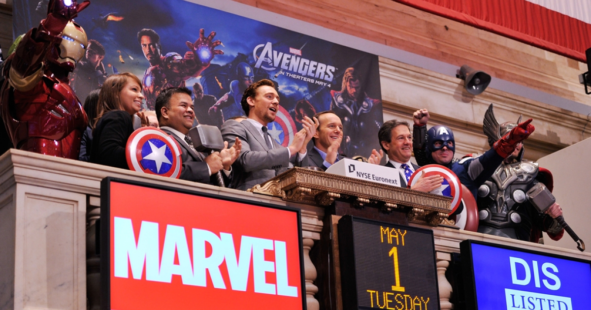 Actors Tom Hiddleston (fourth from left) and Clark Gregg (fourth from right) ring the opening bell at The New York Stock Exchange as part of a celebration of the release of Marvel Studios