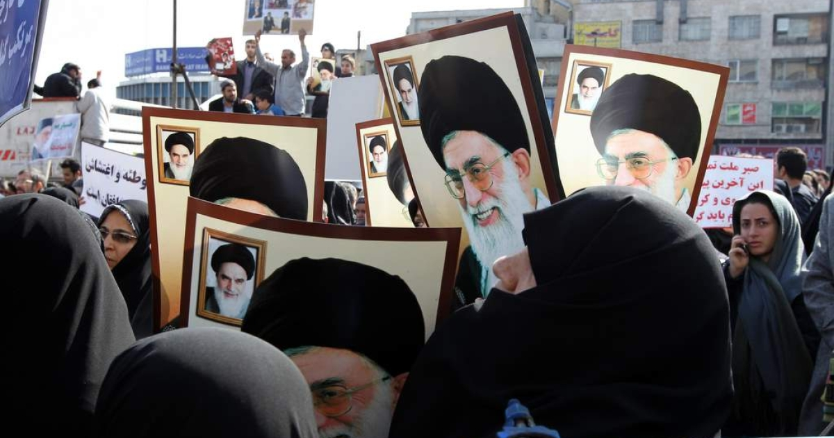 Tens of thousands of Iran regime loyalists, many carrying posters of supreme leader Ayatollah Ali Khamenei, pour on to the streets of Tehran on February 18, 2011, demanding that opposition leaders Mir Hossein Mousavi and Mehdi Karroubi be hanged for their 'rebellion.'</p>