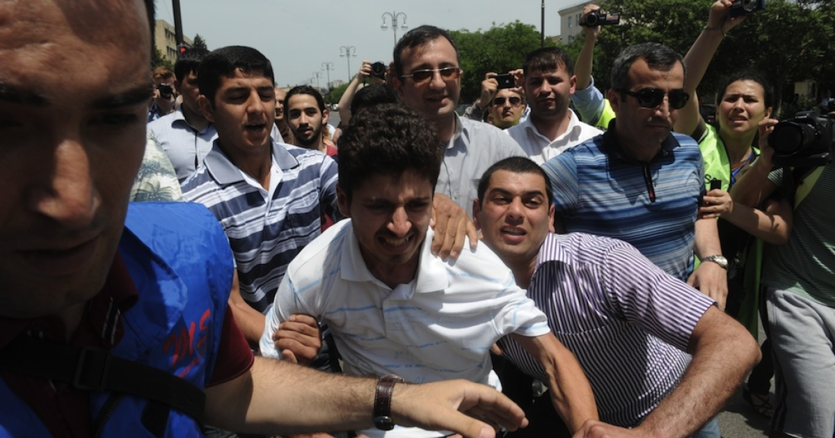 Plainclothes police officers detain opposition activists who tried to hold a rally near public television station which is the Azerbaijani partner for Eurovision broadcasts in Baku, on May 23, 2012.</p>