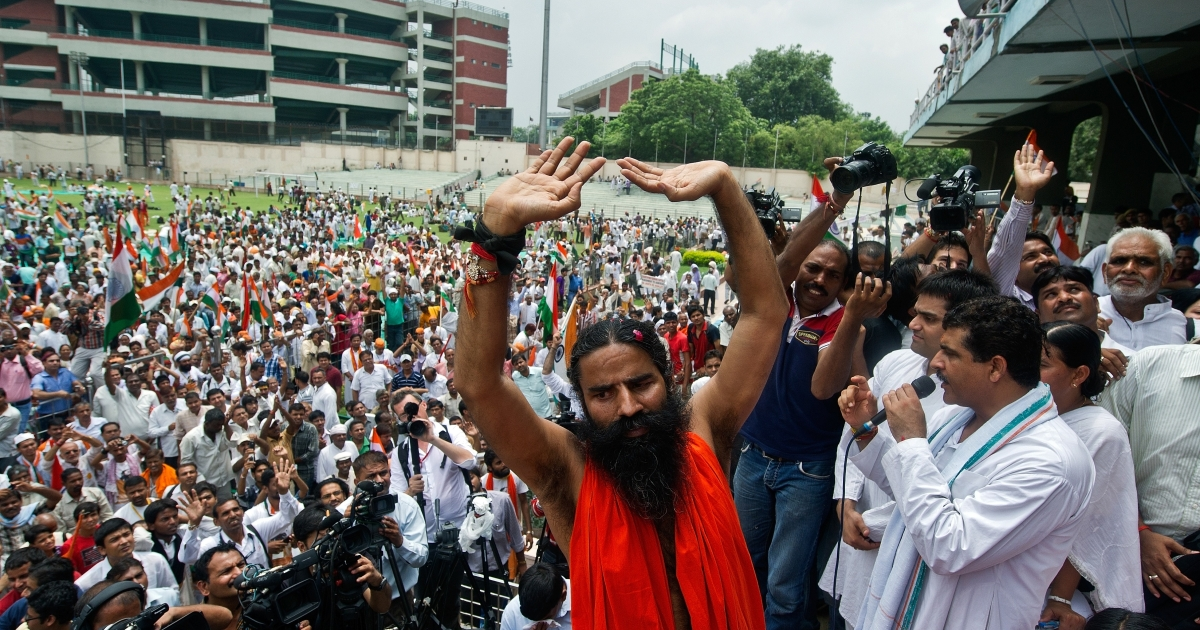 Indian yoga guru Baba Ramdev gestures after breaking his fast at Ambedkar stadium in New Delhi on August 14, 2012.</p>