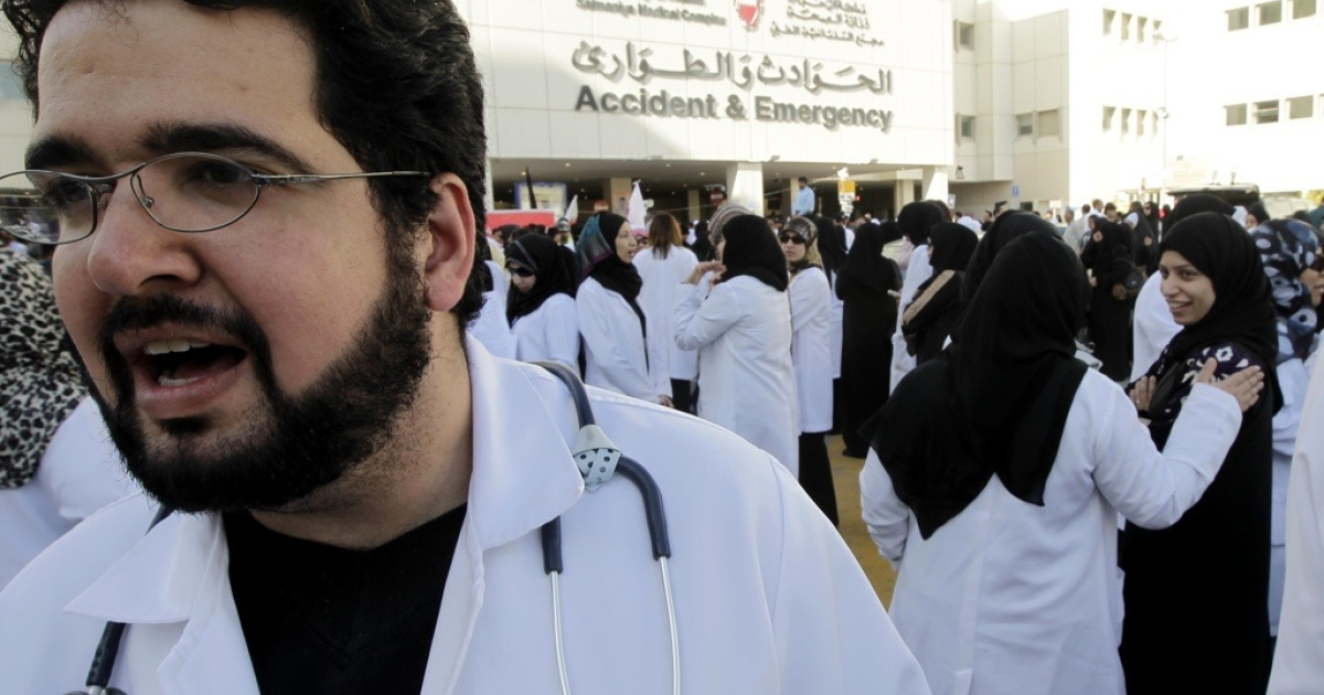 Doctors and nurses gather outside Salmaniya medical complex before marching towards Pearl Square in the Bahraini capital Manama on February 20, 2011 to demand the resignation of Education Minister Majed bin Ali al-Nuaimi and Health Minister Faisal al-Hamr in anti-government protests in the tiny Gulf kingdom.</p>