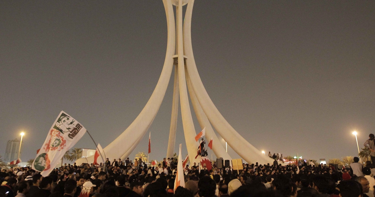 Anti-government protesters gather at Pearl Square in Manama, the capital, for a demonstration calling for regime change on Feb. 16, 2011.</p>