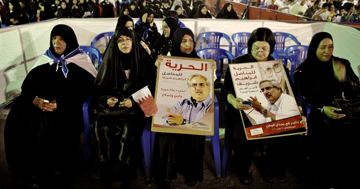 Bahraini Shiite Muslim women hold posters calling for the release of jailed opposition leader Ibrahim Sharif during an anti-government rally in the village of Muqsha, west of Manama, on May 21, 2012. Sectarian tension keeps rising in the tiny Gulf kingdom as the Shiite majority continues to call the ruling Sunni dynasty for political and social reforms.</p>