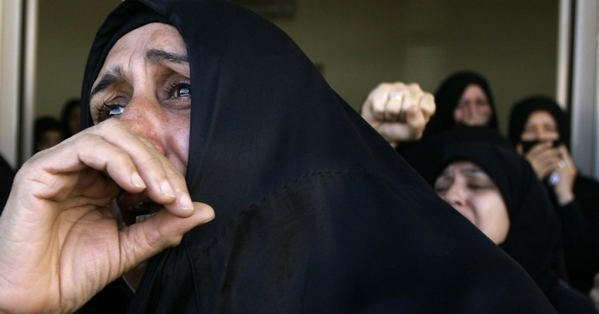 Bahraini Shiite women cry during a funeral for protester killed by government security forces in central Manama on March 22, 2011.</p>