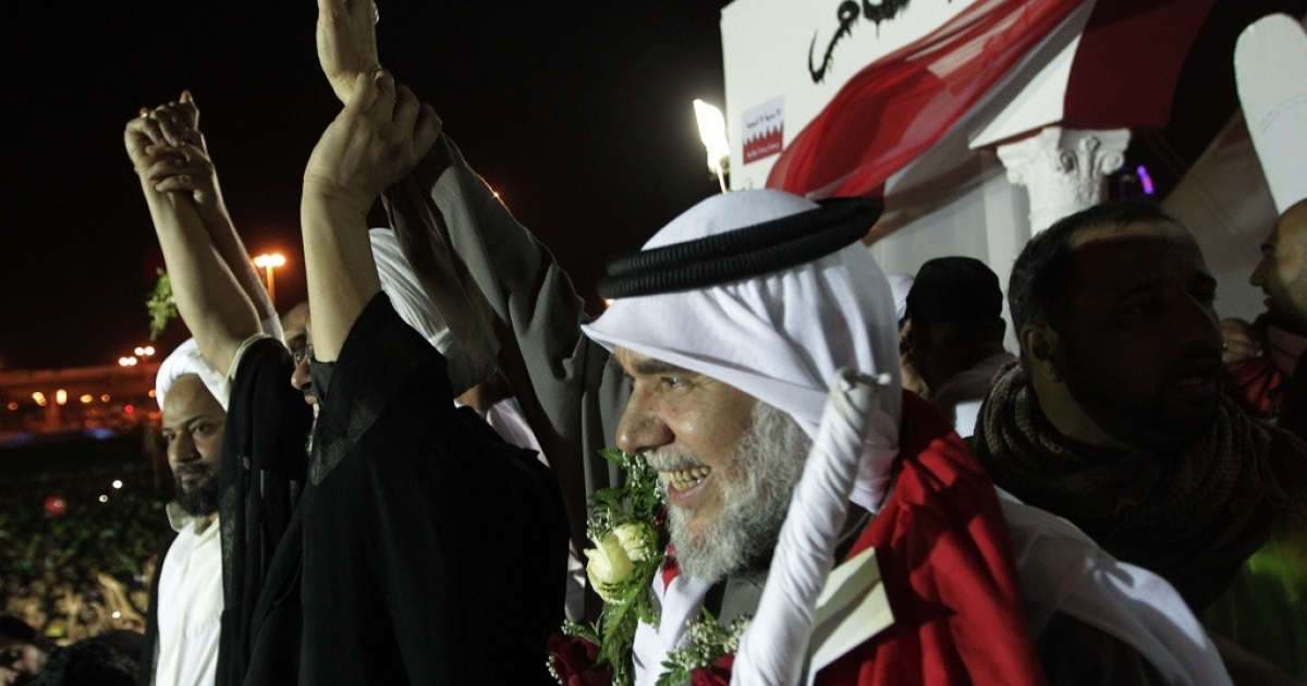 Bahraini Shiite opposition leader Hassan Mashaima, left, greets anti-government protesters gathered at Pearl Square in Manama on February 26, 2011 upon his return from self-imposed exile following assurances from the Gulf kingdom that he had been pardoned of terrorism-related charges. Bahrain's protests put it at the center of the bitter divide between Sunnis and Shias in the Gulf.</p>