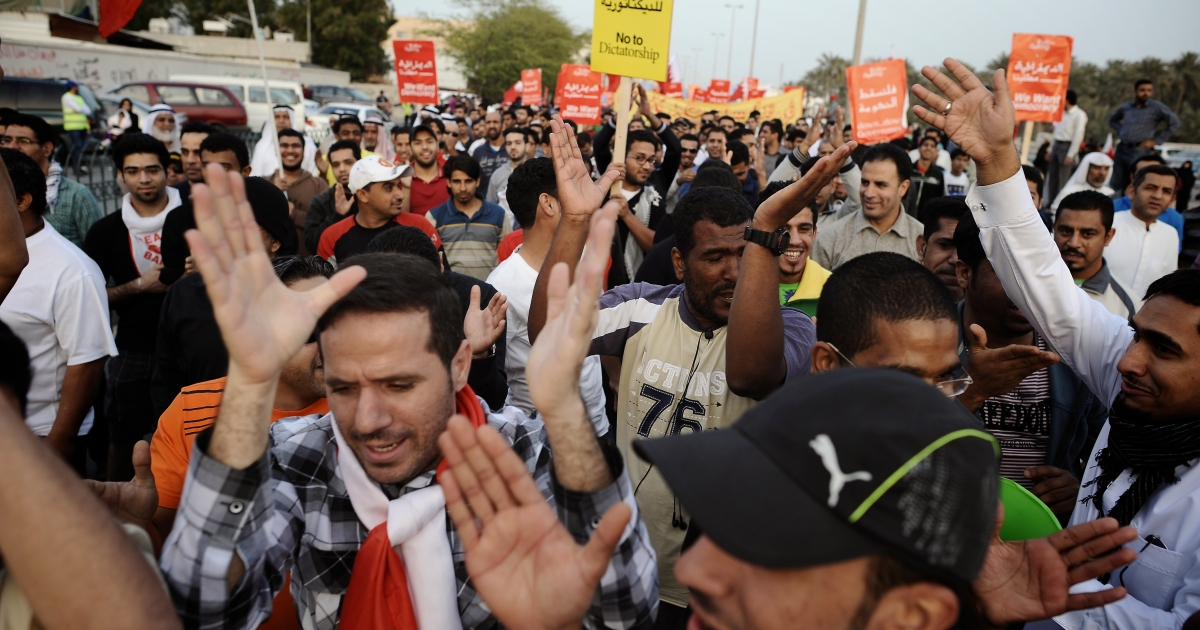 Bahraini Shiite Muslims take part in an anti-government rally in Bilad al-Kadim, a suburb of Manama, on February 24, 2012. Another massive anti-government rally in Manama attracted tens of thousands of protesters on March 9, 2012.</p>