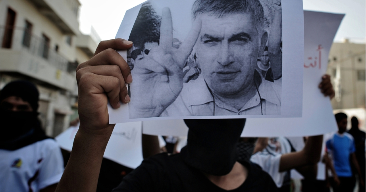 A Bahraini Shiite Muslim youth holds a picture of prominent rights activist Nabeel Rajab during a demonstration in his solidarity along with jailed dissident Abdulhadi Khawaja in the village of Daih, west of Manama, on June 11, 2012. Bahraini authorities re-arrested Rajab on June 6, pending a probe into tweets deemed insulting to Sunnis, prosecutors said, nine days after he had been freed.</p>