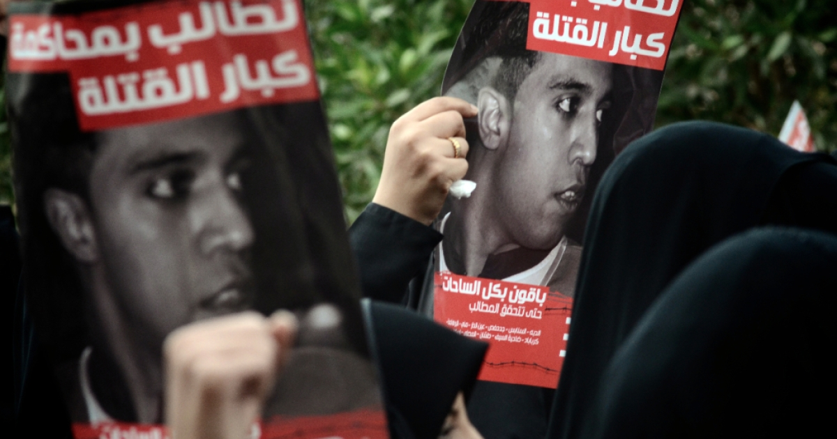 Bahraini women hold posters of Ali Mushaima who was killed last year during the deadly crackdown on street protests, during a rally calling for political reforms in the Shiite village of Jidhafs, West Manama, on March 23, 2012. Thousands of Bahrainis took to the streets of Shiite villages around the capital to demand reforms, with some calling for the ouster of the Sunni-ruled regime.</p>