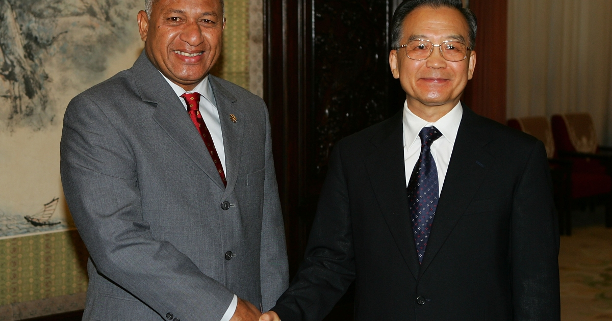 Chinese Premier Wen Jiabao greets Fiji's Prime Minister Commodore Josaia Bainimarama on August 10, 2008 in Beijing. China's support of Fiji's military government has garnered criticism from Australia.</p>