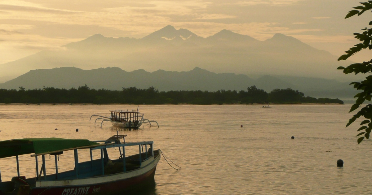 The sun rising over the mountains of the idyllic Indonesian isle of Lombok, near Bali.</p>