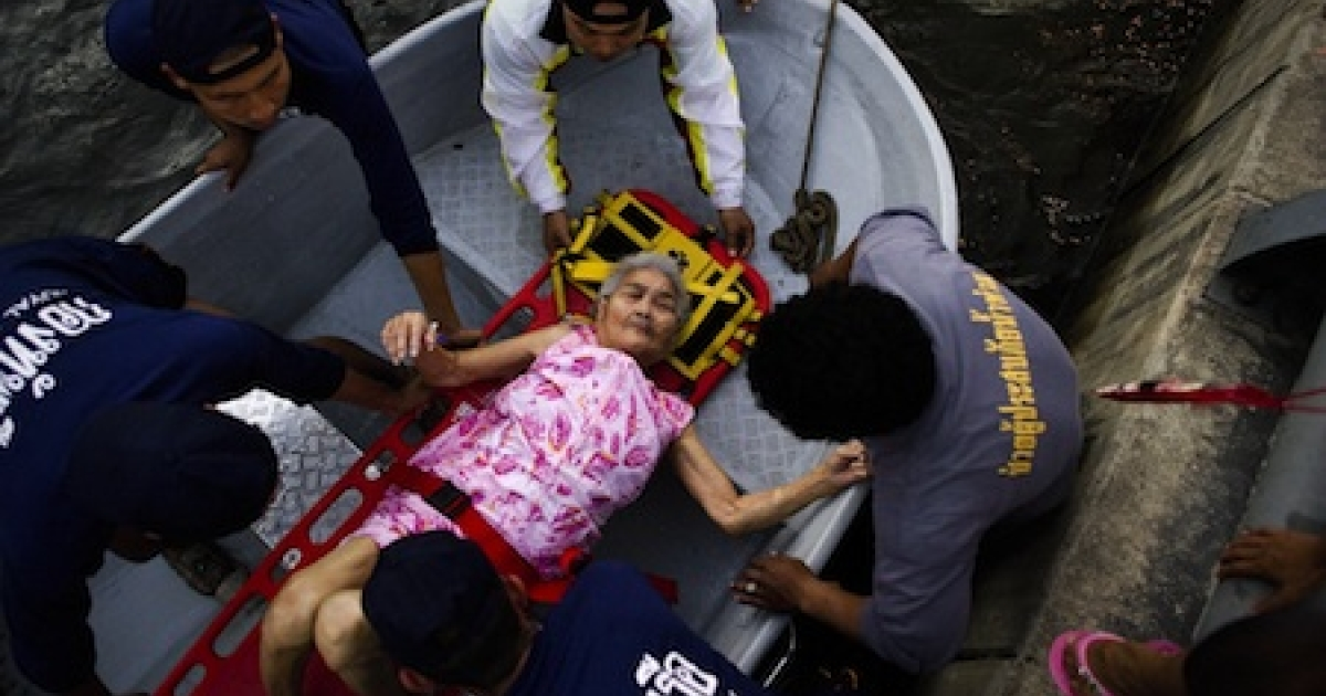 An elderly woman is evacuated from a flood zone to a hospital in Bangkok, on November 6, 2011</p>