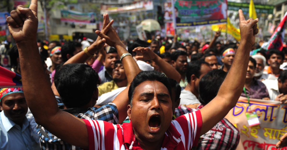 A supporter of the opposition Bangladesh Nationalist Party (BNP) shout slogans as he attends a rally organised by the BNP and allies in Dhaka on March 12, 2012. Thousands of Bangladeshi troops patrolled the streets of Dhaka as opposition parties prepared for a mass protest calling for the government to step down and hold elections.</p>
