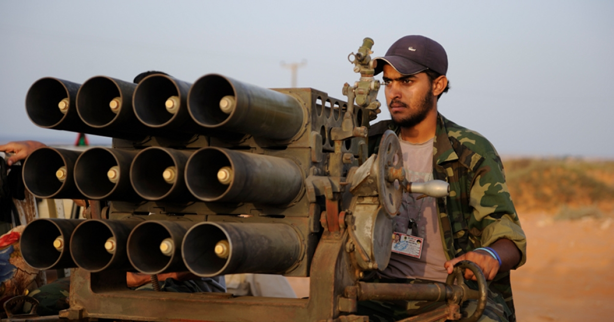 A Libyan rebel fighter sets a target with a rocket launcher on the front line near Sirte, on September 4, 2011. The rebel forces are waiting for the end of the negotiations with pro-Gaddafi forces. Negotiations for the surrender of Bani Walid failed and will not resume, an official said, opening the way for a military attack on that town.</p>