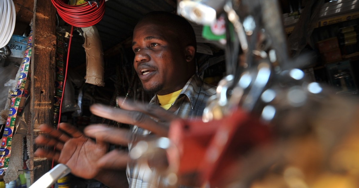 Samuel Mamba poses in his hardware shop in Salima on July 16, 2011. Samuel Mamba saved for three years as a subsistence farmer to open a small hardware stand in Salima before borrowing 20,000 kwacha in 2008 as part of a collective of 10 people. Malawi's microfinance lenders are giving would-be business owners access to capital in a country where 81 percent of people do not have a bank account.</p>