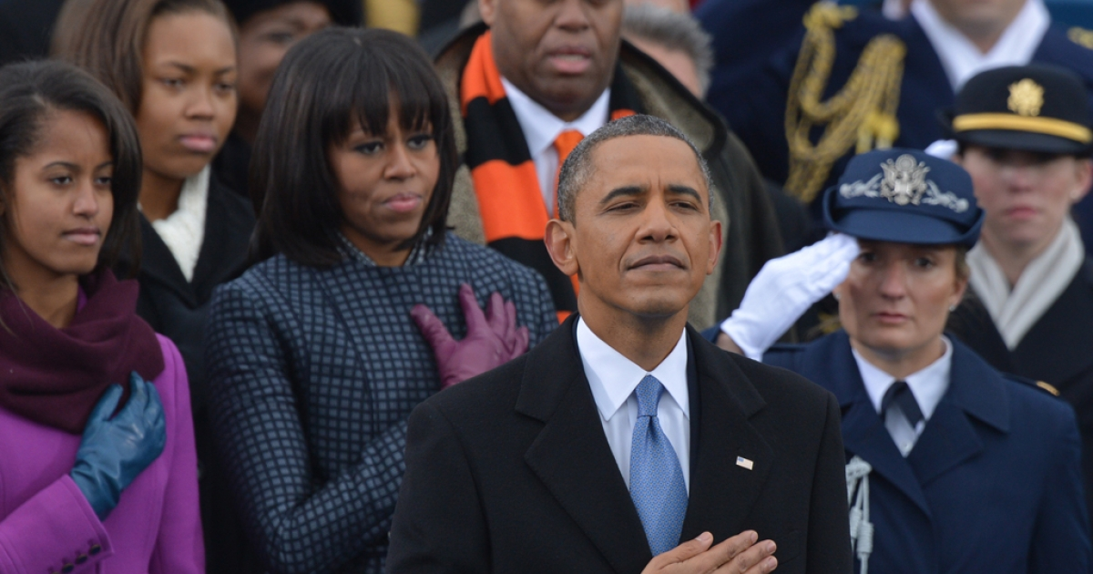 US President Barack Obama, surrounded by members of his family, listens to the National Anthem during the 57th Presidential Inauguration ceremonial swearing-in at the US Capitol on Jan. 21, 2013, in Washington, D.C.</p>