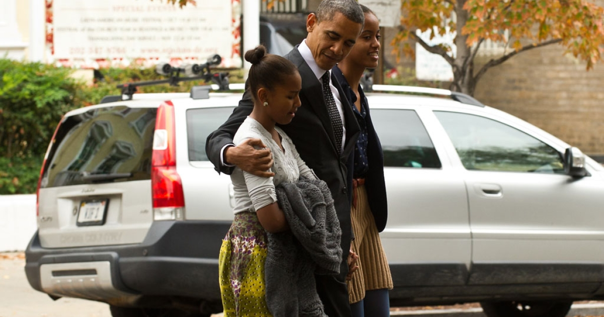 US President Barack Obama and his daughters Malia, left, and Sasha walk to the White House from St. John's church after attending Sunday services in Washington on October 28, 2012.</p>