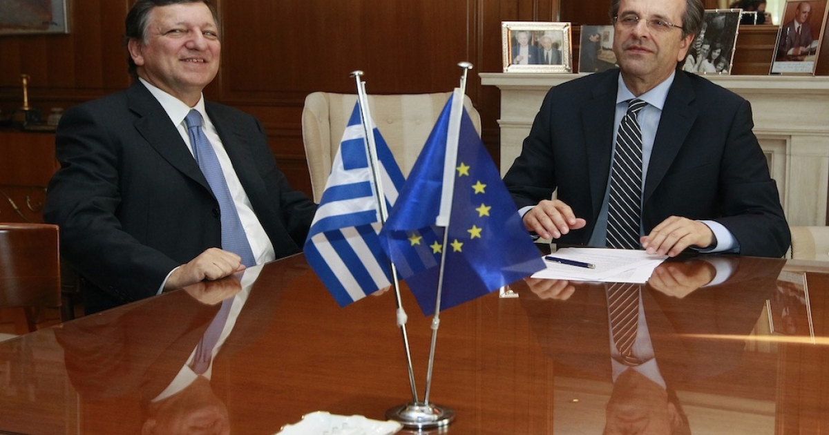 Greek Prime Minister Antonis Samaras (R) meets EU Commission President Jose Manuel Barroso at Samaras' office in Athens July 26, 2012. Greece must present the budget cut plan for 2013-2014 to a team of inspectors from the troika of international lenders visiting Greece this week to assess progress before releasing more funds to the cash-strapped country.</p>