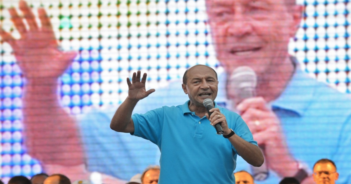Romanian President Traian Basescu speaks to supporters during an election rally in Bucharest on July 26, 2012.</p>