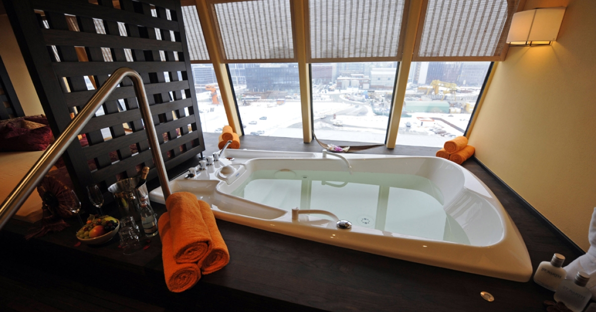 A bathtub can be seen in a wellness suite on cruise liner