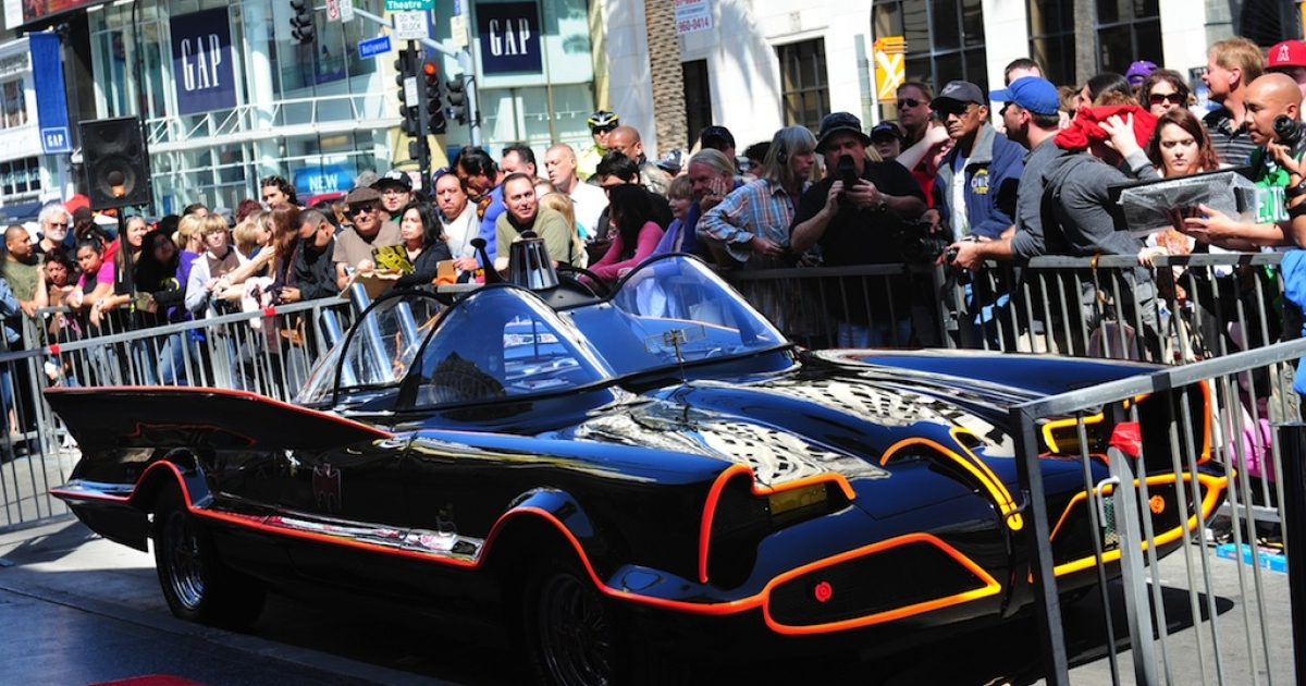A crowd gathers around the Batmobile, cordoned off ahead of a ceremony for Adam West, who played Batman in the original TV series, for the unveiling of his star on Hollywood's Walk of Fame on April 5, 2012 in Hollywood, California.</p>