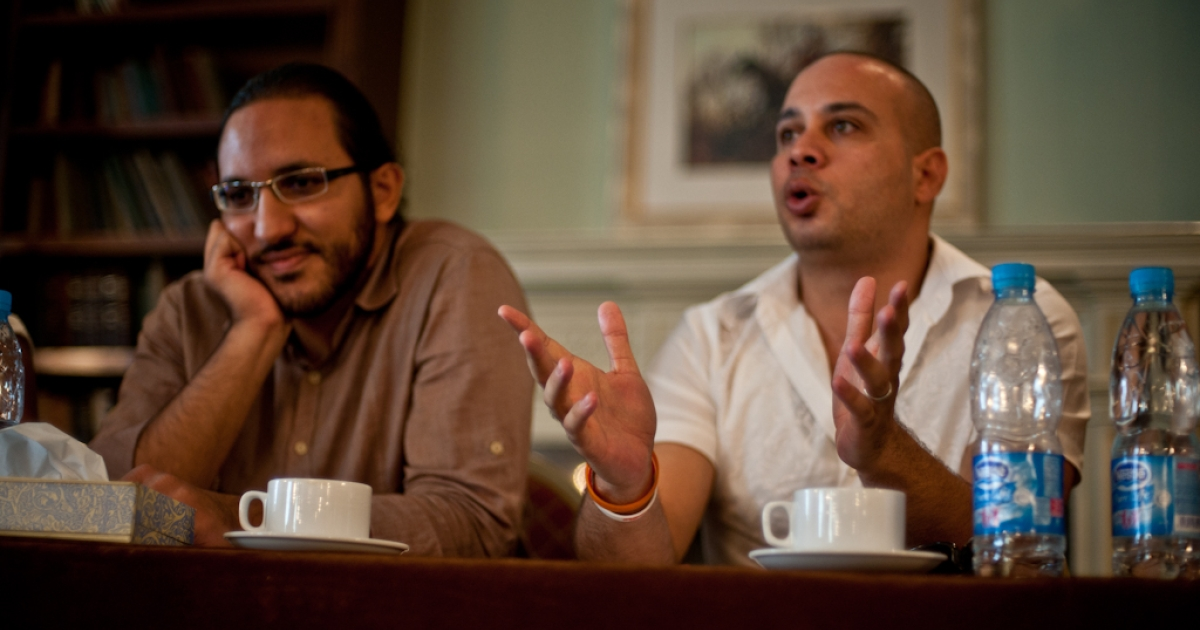 Ramy Raoof (L) and Ahmed Maher (R) speak at the Open Hands Initiative / GlobalPost  'Covering a Revolution' seminar in Cairo, October 2011.</p>