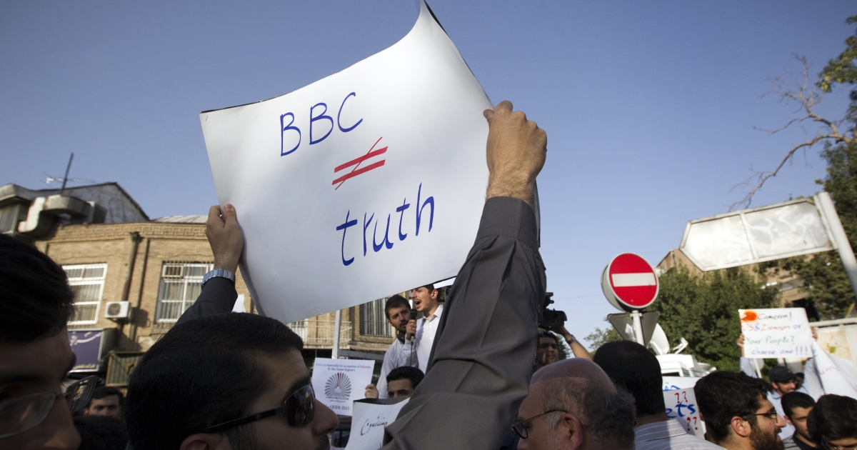 An Iranian hardline student holds a sign opposed to the BBC during a demonstration in August outside the British Embassy in Tehran to protest against what students called the 'savage' crackdown by British police on rioters in London.</p>