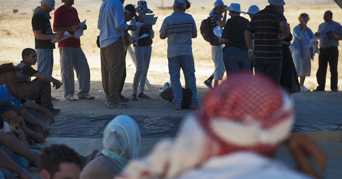 Bedouins, who are Muslims, and Jews attend an interfaith prayer in a makeshift tent in al-Araqib, a Bedouin village in the Negev Desert which has been razed more than a dozen times by Israeli police in the last 12 months.</p>