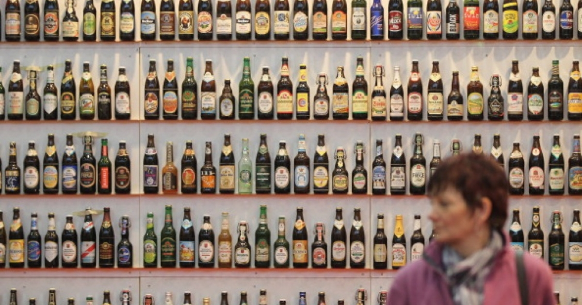 A woman walks among hundreds of bottles of German beer, meant to represent the approximately 5,000 brands of German beer, at a stand at the 2011 Gruene Woche international agricultural trade fair at Messe Berlin on January 21, 2011 in Berlin, Germany.</p>