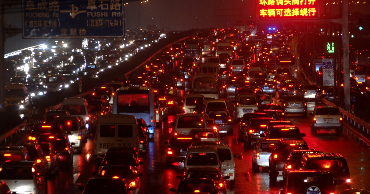 A traffic jam in Beijing on June 23, 2011 due to rainstorms that flooded a large part of the city.</p>