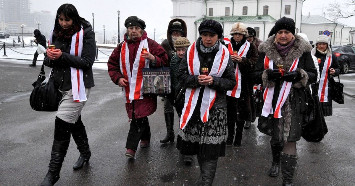 Belarus opposition supporters mark the three-month anniversary of the Belarus presidential election in Minsk on March 19, 2011.</p>