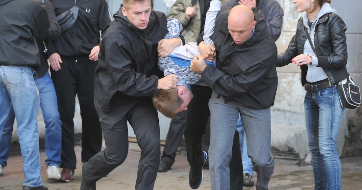 Plain clothed Belarusian policemen detain activists during an Independence Day celebration in Minsk on July 3, 2011.</p>