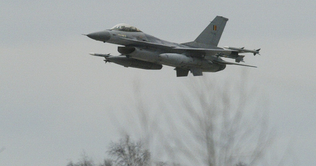 SIAULIAI, LITHUANIA: A Belgian Air Force F-16 flies over the Zokiniai airfield near Siauliai 29 March 2004. Allied air forces will take turns patrolling the air space of Lithuania, Latvia, and Estonia following a decision made by NATO.</p>