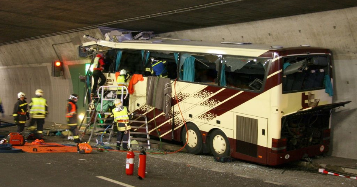In this handout image provided by police, the bus is seen where it crashed inside a motorway tunnel near Sierre, southern Switzerland.</p>