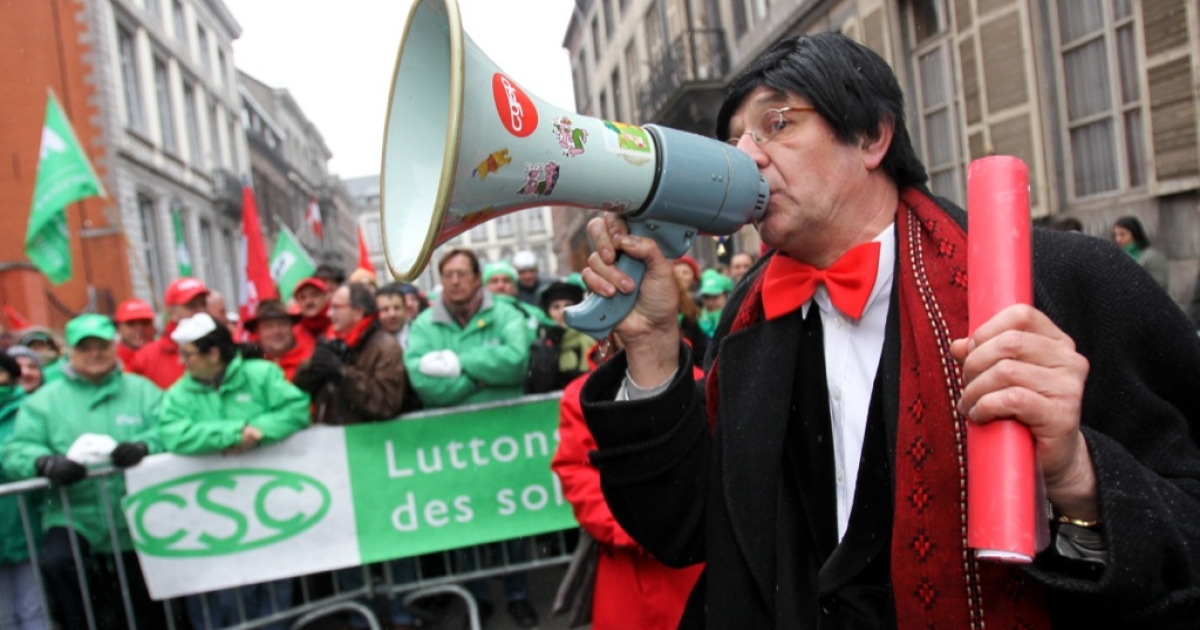 A man dressed as Belgian Prime Minister Elio Di Rupo uses a megaphone during a symbolic strike action of CSC Christian Union of Mons-La Louviere, in front Di Rupo's residence in Mons on Jan. 30, 2012. Belgium was in chaos today, just hours before an EU summit, with transport and other public services halted by a national strike called by unions in protest at EU-ordered austerity measures.</p>