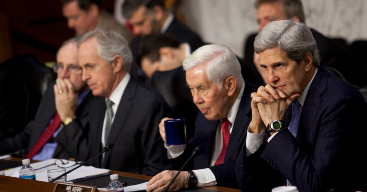 Sen. James Risch (R-ID), Sen. Bob Corker (R-TN), Sen. Richard Lugar (R-IN) and Committee Chairman Sen. John Kerry (D-MA) listen to testimony during the Senate Foreign Relations Committee hearing on the September 11th attacks on the U.S. Consulate in Benghazi, on Capitol Hill, December 20, 2012 in Washington, DC.</p>