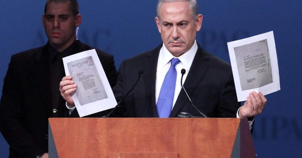 Israeli Prime Minister Benjamin Netanyahu shows copies of WW2 correspondence between the US War Department and Jewish leaders, during his speech to the American-Israeli Public Affairs Committee in Washington, March 5, 2012. The American military refused requests to bomb the Auschwitz concentration camp because it was considered too risky.</p>