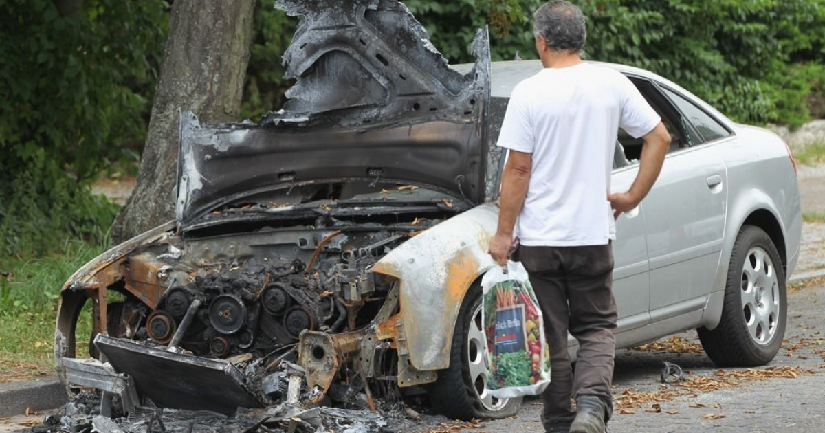 One of hundreds of cars set ablaze during a series of car arsonies in Berlin, Germany in August 2011.</p>