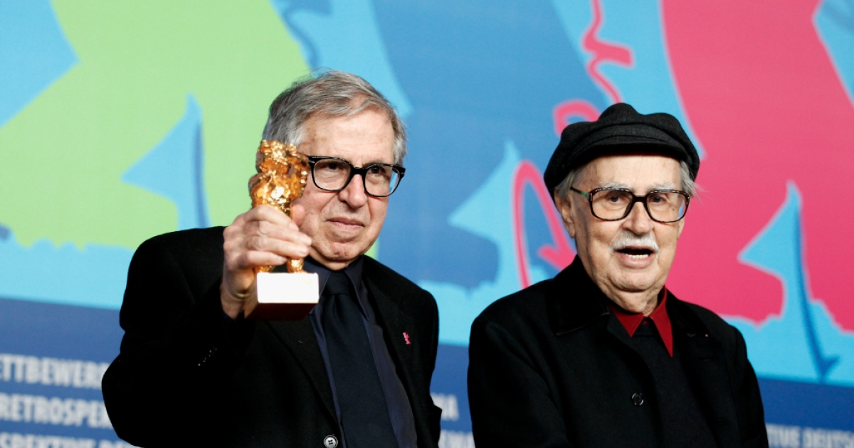 Italian directors Vittorio and Paolo Taviani receive the Golden Bear prize for their film