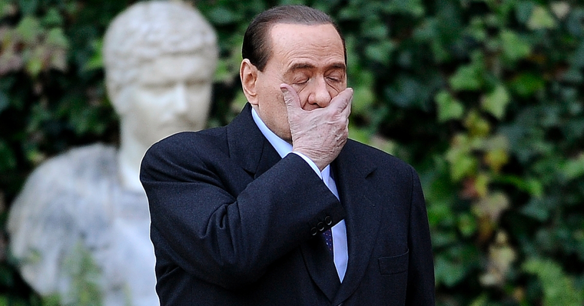 Silvio Berlusconi: is he peering into the future in this photo taken earlier this year?</p>