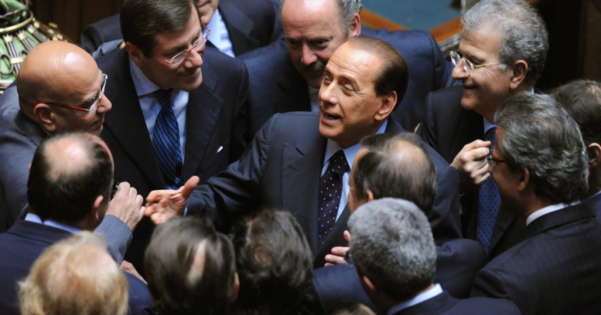 Italy's prime minister Silvio Berlusconi speaks with deputies before former neo-fascist Gianfranco Fini was elected speaker of Italy's Chamber of Deputies on April 30, 2008, in Rome.</p>
