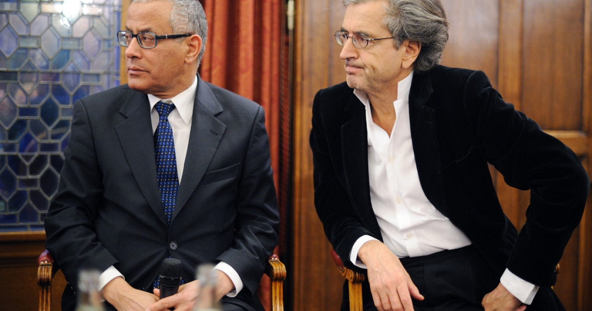 French academic Bernard-Henri Levy, right, gives a press conference with Libyan opposition representative Ali Zeidan, left, on March 22, 2011.</p>
