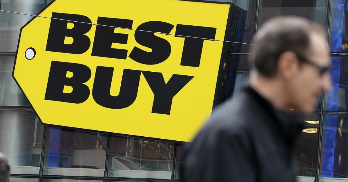 A pedestrian walks by a Best Buy store on April 10, 2012, in New York City.</p>