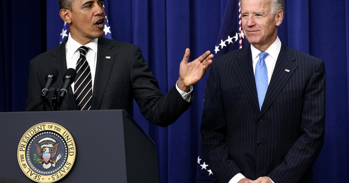 US President Barack Obama (L) speaks with Vice President Joe Biden. Biden said he is